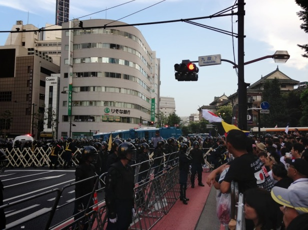 Here are the police everywhere, notice the riot buses blocking the route to the shrine